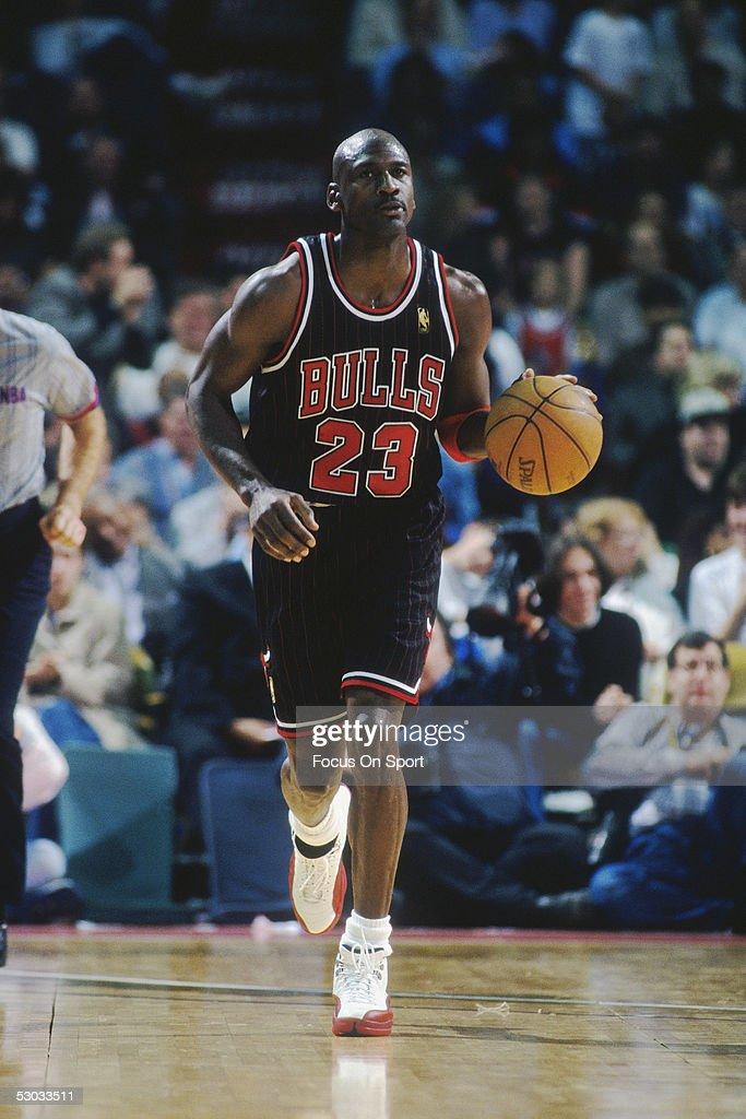 Chicago Bulls' center Michael Jordan dribbles downcourt