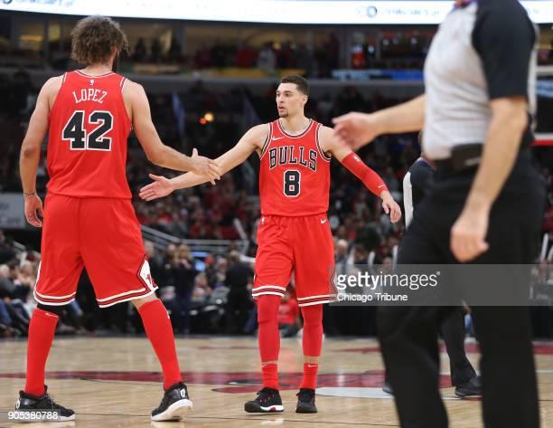 Chicago Bulls center Robin Lopez congratulates Chicago Bulls guard Zach LaVine on a late threepoint basket in the first half of an NBA basketball...