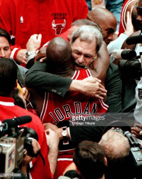 Chicago Bull's coach Phil Jackson hugs Michael Jordan after the Bulls won their 6th championship at the Delta Center in Salt Lake City Utah in 1998