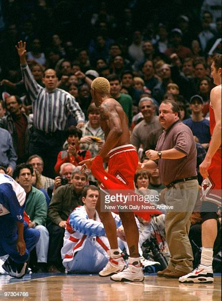Chicago Bulls' Dennis Rodman disrobes after being ejected during game against New Jersey Nets Rodman was ejected after headbutting referee Ted...