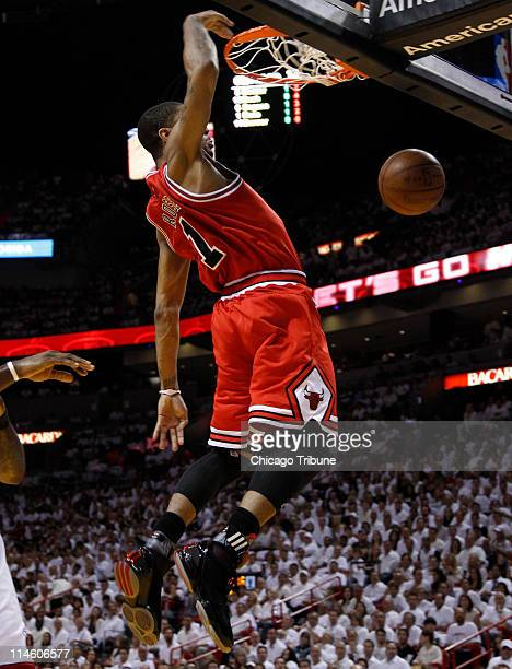 Chicago Bulls' Derrick Rose dunks against the Miami Heat during the first quarter in Game 4 of the NBA's Eastern Conference finals at the American...