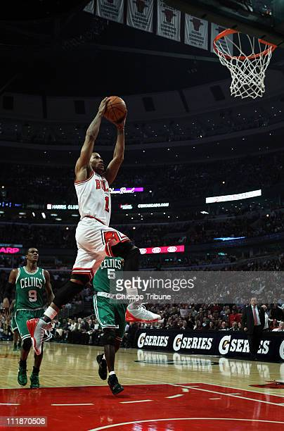 Chicago Bulls' Derrick Rose flies in for a dunk in the first half against the Boston Celtics at the United Center in Chicago Illinois on Thursday...