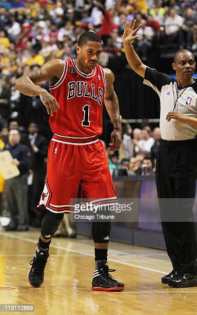 Chicago Bulls' Derrick Rose limps back to bench after suffering an injury in the first half against the Indiana Pacers in Game 4 of the NBA Eastern...