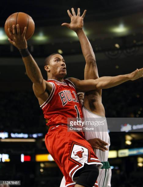 Chicago Bulls' Derrick Rose scores against Boston Celtics' Paul Pierce during Game 1 of the Eastern Conference Quarterfinals at Northbank Garden in...