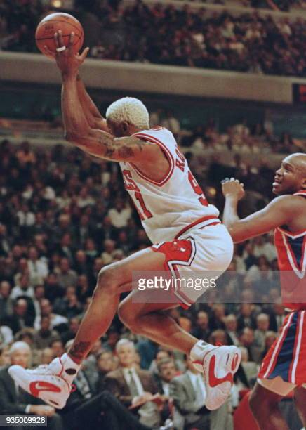 Chicago Bulls forward Dennis Rodman pulls down a rebound against Philadelphia 76ers forward Sharone Wright in the first quarter 16 January at the...