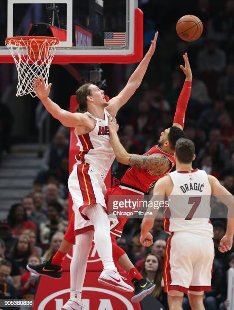 Chicago Bulls forward Denzel Valentine lofts a shot over Miami Heat center Kelly Olynyk in the second half of an NBA basketball game at the United...