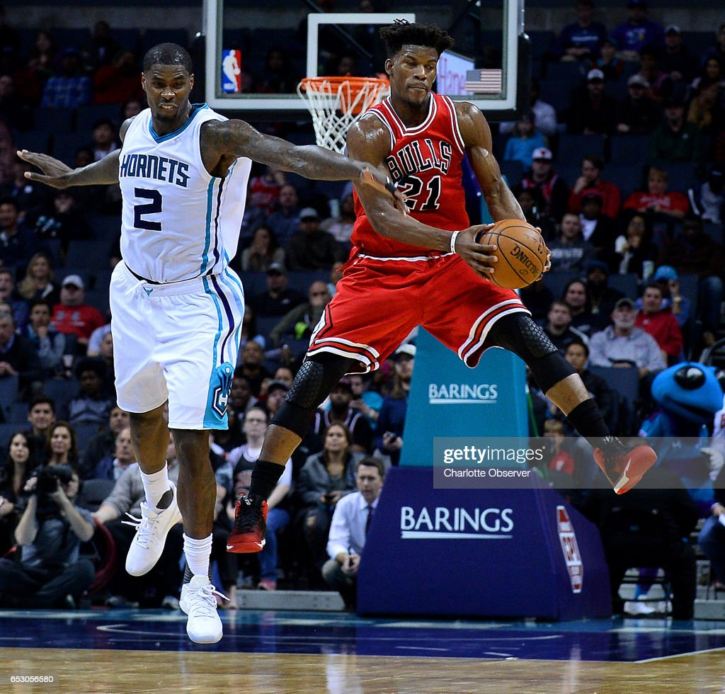 Chicago Bulls forward Jimmy Butler, right, is fouled by Charlotte Hornets forward Marvin Williams, left, during late second half action on Monday, March 13, 2017 at the Spectrum Center in Charlotte, N.C. The Bulls defeated the Hornets 115-109.