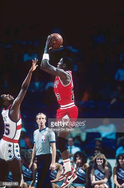 Chicago Bulls' forward Michael Jordan makes a jumpshot during a game against the Washington Bullets at Capital Centre circa 1985 in Washington DC...