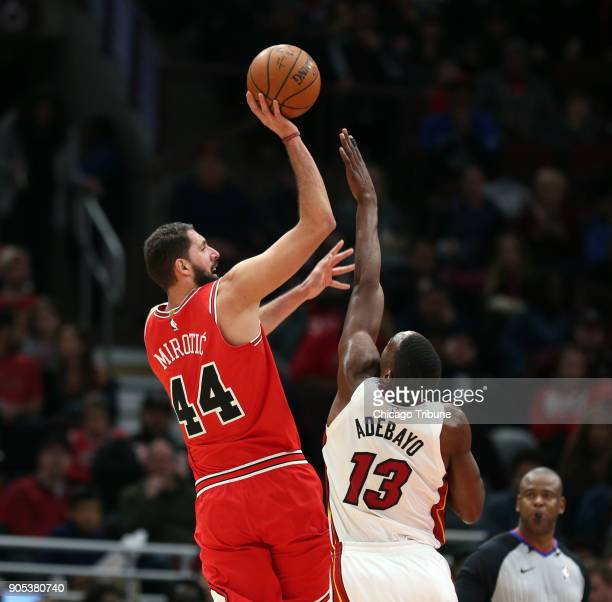 Chicago Bulls forward Nikola Mirotic shoots over Miami Heat center Bam Adebayo in the second half of an NBA basketball game at the United Center in...
