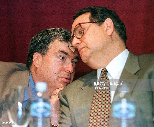 Chicago Bulls General Manager Jerry Krause confers with Bulls Chairman Jerry Reinsdorf during a press conference 23 July at the United Center in...
