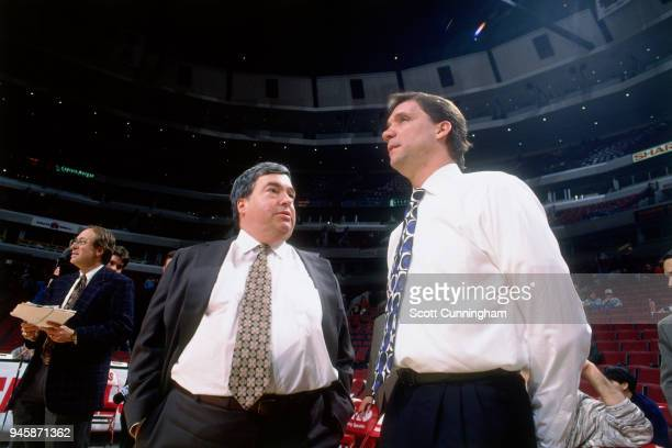 Chicago Bulls General Manager Jerry Krause talks to Head Coach Flip Saunders of the Minnesota Timberwolves before the game on February 27 1996 at the...
