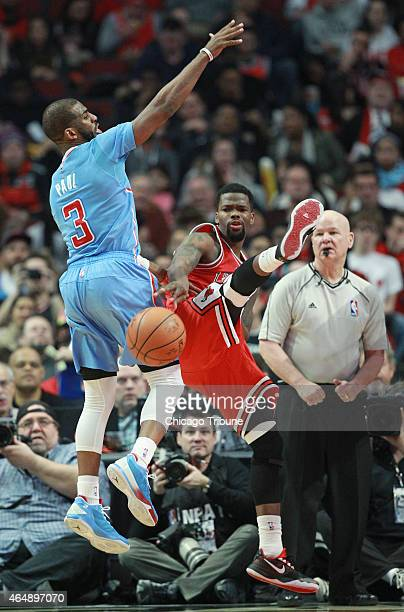 Chicago Bulls guard Aaron Brooks passes the ball as Los Angeles Clippers guard Chris Paul defends during the third quarter on Sunday March 1 at the...