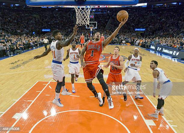 Chicago Bulls guard Derrick Rose gets inside New York Knicks defense for shot. New York Knicks vs Chicago Bulls, Opening Night at Madison Square...