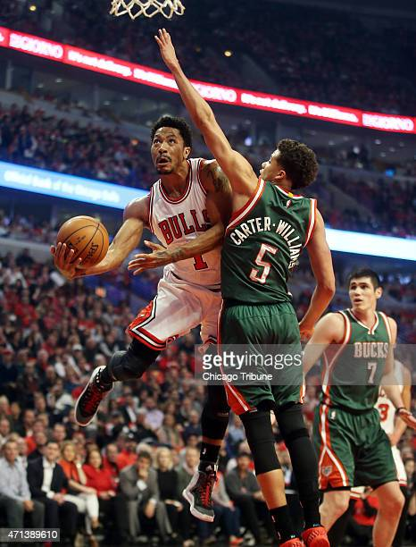 Chicago Bulls guard Derrick Rose scores around Milwaukee Bucks guard Michael CarterWilliams during the first half on Monday April 27 at the United...