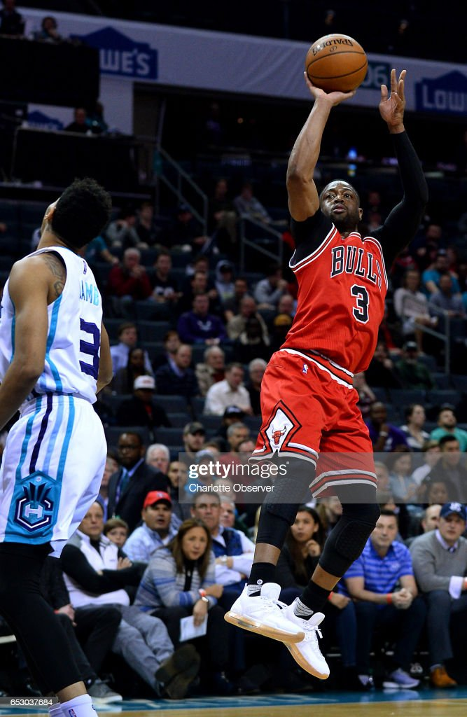 Chicago Bulls guard Dwyane Wade, right, releases a two-point basket as Charlotte Hornets guard Jeremy Lamb, left, looks on during first half action on Monday, March 13, 2017 at the Spectrum Center in Charlotte, N.C.