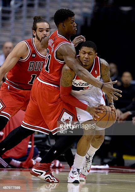 Chicago Bulls guard Jimmy Butler applies tight defense on Washington Wizards guard Bradley Beal in the first quarter at the Verizon Center in...