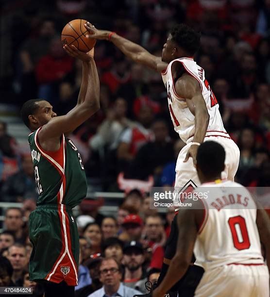 Chicago Bulls guard Jimmy Butler blocks a shot by Milwaukee Bucks guard Khris Middleton during the first half on Monday April 20 at the United Center...