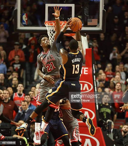 Chicago Bulls guard Jimmy Butler blocks the last shot of the game by Indiana Pacers forward Paul George which would have been the winning basket on...