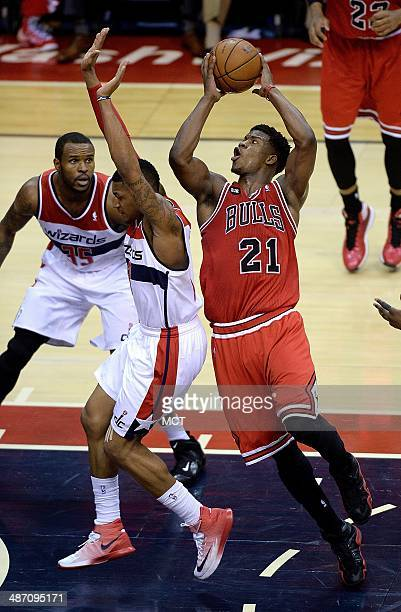Chicago Bulls guard Jimmy Butler drives around Washington Wizards guard Bradley Beal for a shot during the second half of their first round playoff...