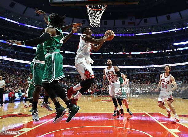 Chicago Bulls guard Jimmy Butler eludes two Boston Celtics defenders during the first half on Saturday Nov 8 at the United Center in Chicago