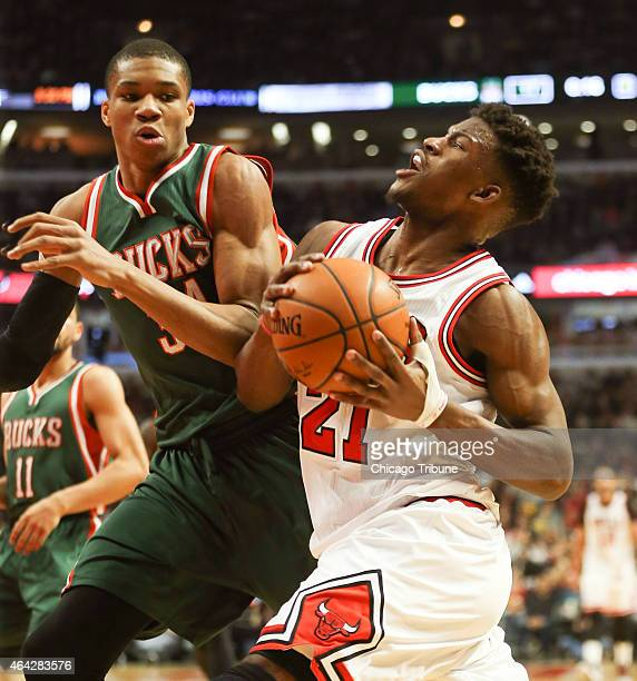 Chicago Bulls guard Jimmy Butler gets around Milwaukee Bucks forward Giannis Antetokounmpo during the first half on Monday Feb 23 at the United...