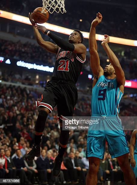 Chicago Bulls guard Jimmy Butler goes to the basket ahead of Charlotte Hornets guard Gerald Henderson during the first half on Monday March 23 at the...