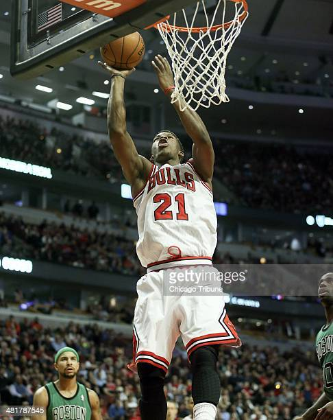 Chicago Bulls guard Jimmy Butler makes a basket against the Boston Celtics during the first half at the United Center in Chicago on Monday March 31...