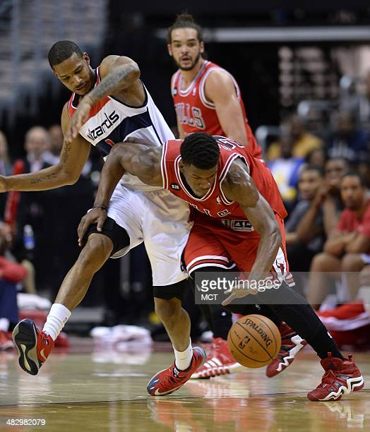 Chicago Bulls guard Jimmy Butler recovers the ball against Washington Wizards forward Trevor Ariza in the third quarter at the Verizon Center in...