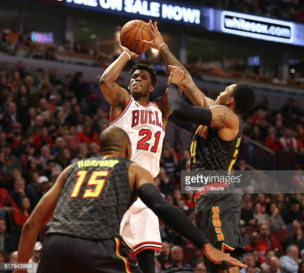 Chicago Bulls guard Jimmy Butler takes a shot over Atlanta Hawks center Al Horford during the second half on Monday March 28 at the United Center in...