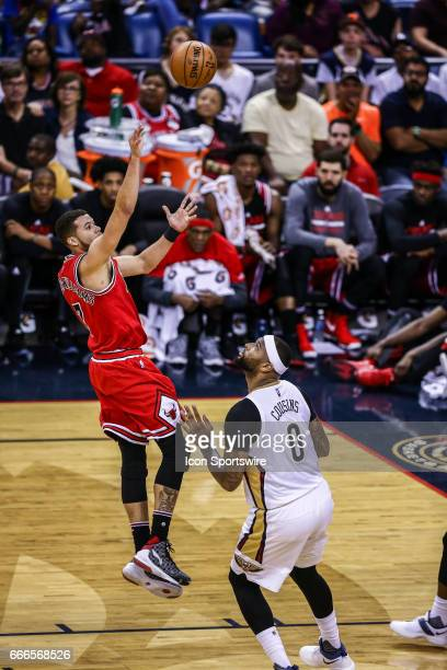 Chicago Bulls guard Michael CarterWilliams shoots a jump shot against New Orleans Pelicans forward DeMarcus Cousins during the game between the New...