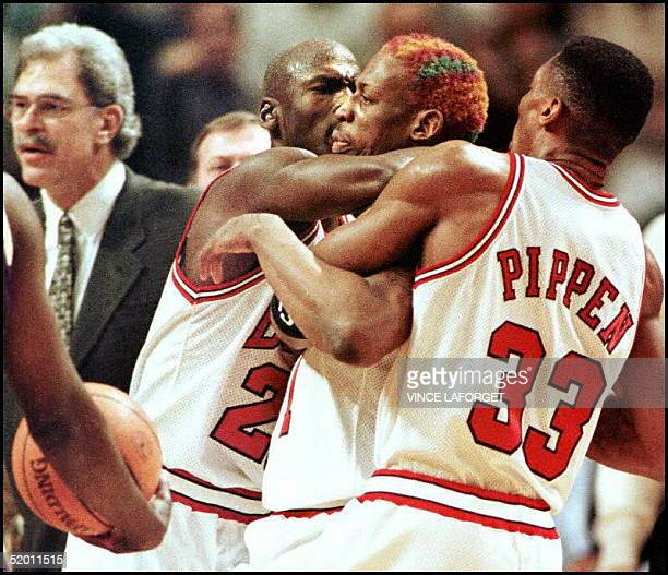 Chicago Bulls guard Michael Jordan and Scottie Pippen keep Dennis Rodman away from the Los Angeles Lakers' Shaquille O'Neal after O'Neal pushed...