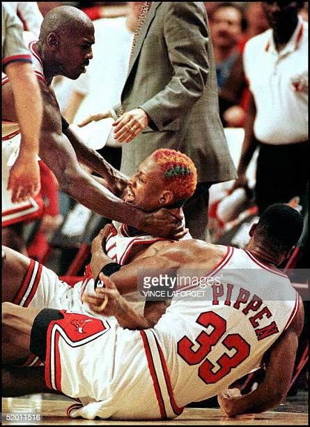 Chicago Bulls guard Michael Jordan and Scottie Pippen tackle Dennis Rodman to keep him away from Shaquille O'Neal after O'Neal shoved Rodman after a...