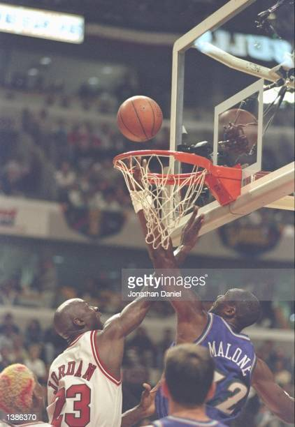 Chicago Bulls guard Michael Jordan attempts to block a shot by Utah Jazz forward Karl Malone during game one of the NBA Finals at the United Center...