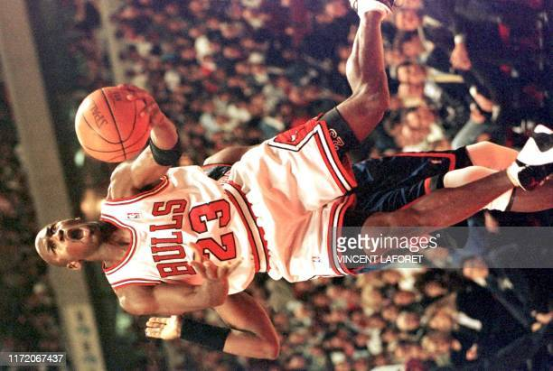 Chicago Bulls guard Michael Jordan drives past New York Knicks center Patrick Ewing during the first quarter of the 09 December game at the United...