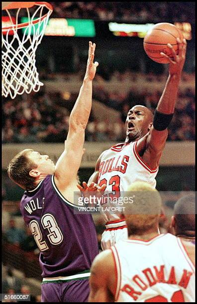 Chicago Bulls guard Michael Jordan drives toward the basket as Milwaukee Bucks forward Joe Wolf tries to defend in the first quarter, 03 March at the...