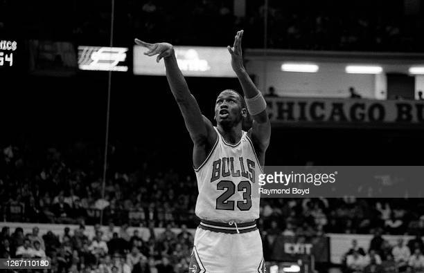 Chicago Bulls guard Michael Jordan follows through on his free throw during a game against the Seattle SuperSonics at Chicago Stadium in Chicago,...