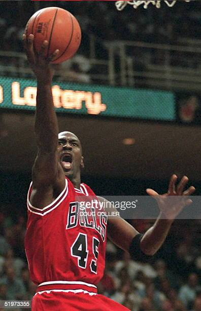 Chicago Bulls guard Michael Jordan goes up for two points during 17 April NBA game against the Miami Heat in Miami. The Bulls defeated the Heat,...