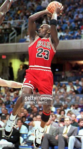 Chicago Bulls guard Michael Jordan makes a jump shot in the second period of Chicago's 14 April game against the Cleveland Cavaliers at Gund Arena in...