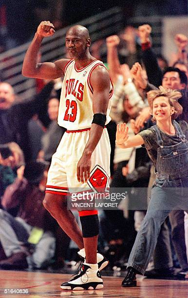 Chicago Bulls guard Michael Jordan pumps his fist as he is congratulated by fans after he made the gamewinning basket against the Atlanta Hawks...