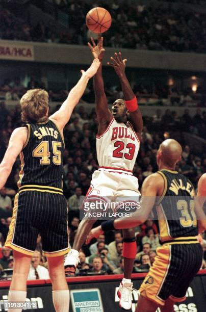 Chicago Bulls guard Michael Jordan shoots past Indiana Pacers center Rik Smits and guard Reggie Miller during the first quarter 17 February at the...