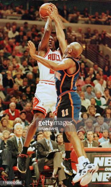 Chicago Bulls guard Michael Jordan shoots the ball past New York Knicks guard Derek Harper in the second quarter of the first game of the NBA Eastern...