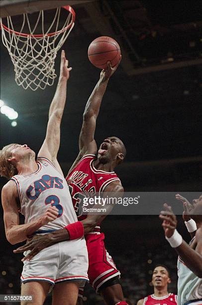 Chicago Bulls guard Michael Jordan shoots the basketball over his defender Craig Ehlo of the Cleveland Cavaliers Richfield Ohio April 16 1989