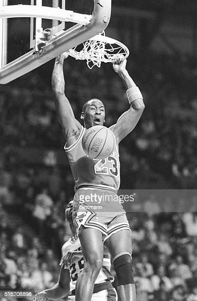 Chicago Bulls' guard Michael Jordan slams home a dunk shot on an alley-oop pass during the 1st quarter of the game 12/12.