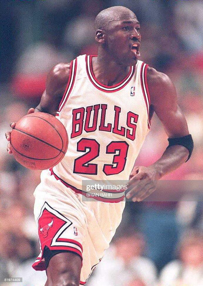 Chicago Bulls guard Michael Jordan wears his old number 23 as he