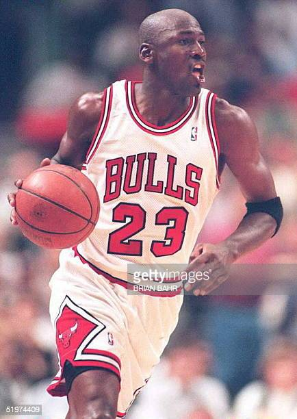 Chicago Bulls guard Michael Jordan wears his old number 23 as he runs down the court in the Eastern Conference semifinals 12 May at the United Center...