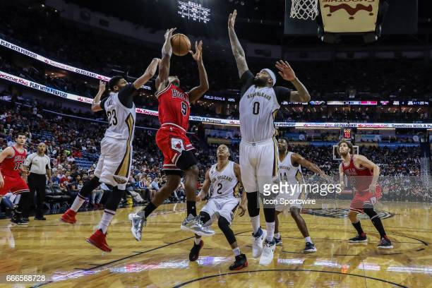 Chicago Bulls guard Rajon Rondo has a shot blocked by New Orleans Pelicans forward Anthony Davis during the game between the New Orleans Pelicans and...