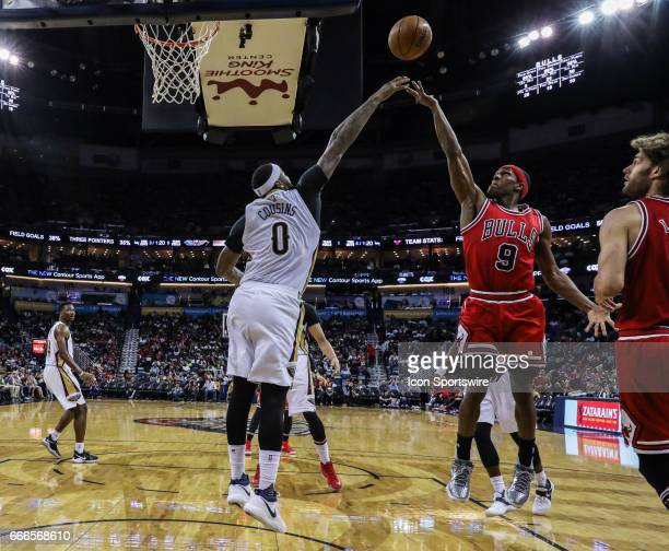 Chicago Bulls guard Rajon Rondo shots a jump shot against New Orleans Pelicans forward DeMarcus Cousins during the game between the New Orleans...