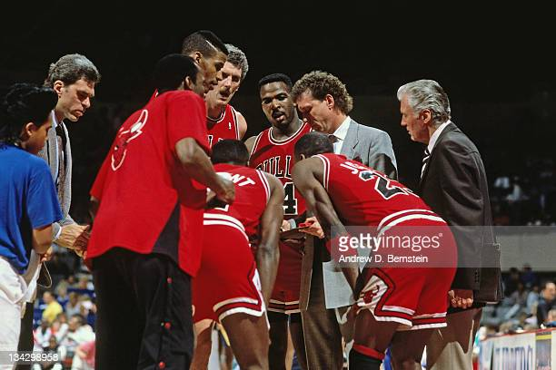 Chicago Bulls head coach Doug Collins huddles his team against the Los Angeles Lakers circa 1987 at the Great Western Forum in Inglewood California...