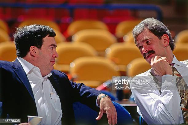 Chicago Bulls head coach Phil Jackson and General Mananger Jerry Krause talk against the Sacramento Kings on November 30 1991 at Arco Arena in...