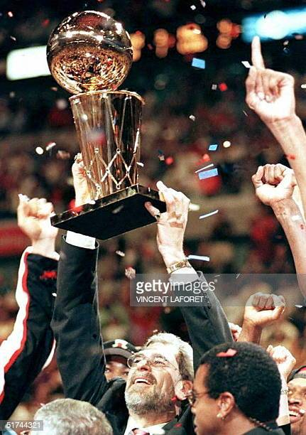 Chicago Bulls head coach Phil Jackson holds the Larry O'Brien Trophy after his team won the NBA Championship by defeating the Utah Jazz 9086 at the...